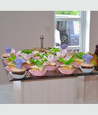 Muffins with matchname flowers. Possible, chocolate, cream, caramel, and other toppings. Minimum quantity 6 PCs.